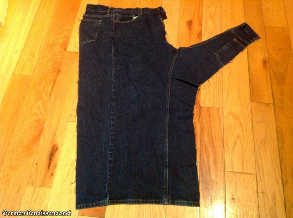 An old pair of jeans cut along the back of the leg.